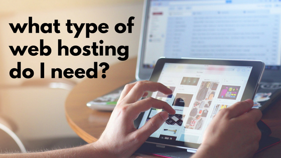 "Black text ""what type of web hosting do I need?"" against individual's workspace as someone browses on a tablet"